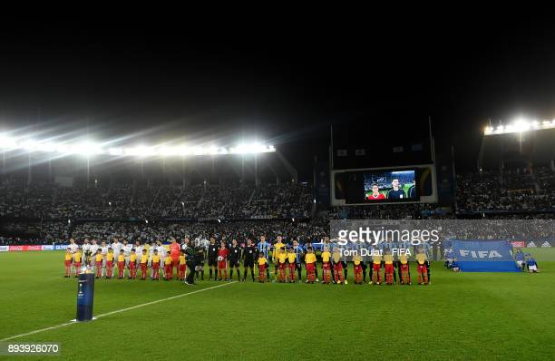 Both teams line up prior to the FIFA Club World Cup UAE 2017 final match between Gremio and Real Madrid at Zayed Sports City Stadium on December 16...