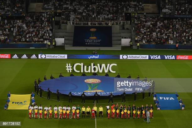 Both teams line up prior to the FIFA Club World Cup UAE 2017 semi final match between Al Jazira and Real Madrid CF at Zayed Sports City Stadium on...