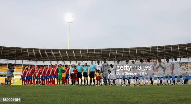 Both teams line up prior to the FIFA U17 World Cup India 2017 group C match between Costa Rica and Guinea at Pandit Jawaharlal Nehru Stadium on...