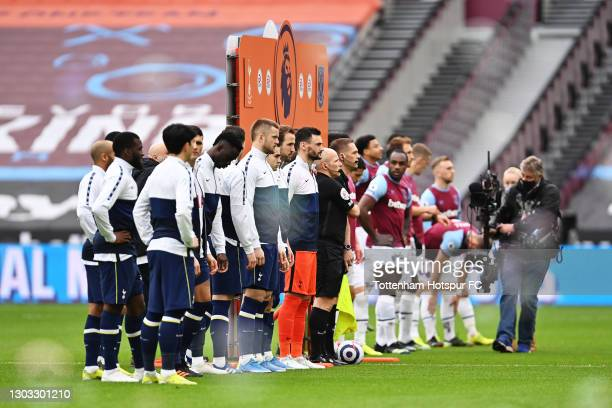 Both team's line up prior to the Premier League match between West Ham United and Tottenham Hotspur at London Stadium on February 21, 2021 in London,...