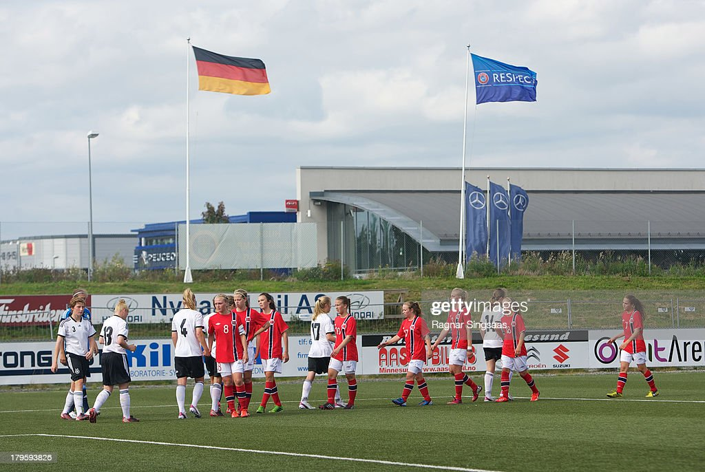 . Both teams line up to shake hands after the Girls Friendly match between Norway U16 and Germany U16 at the UKI Arena on September 5, 2013 in Jessheim, Norway.