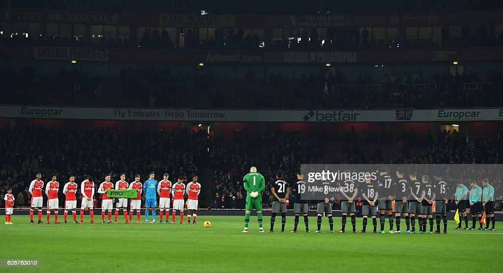 Both teams observe a minutes silence ahead of the EFL Cup quarter final match between Arsenal and Southampton at the Emirates Stadium on November 30, 2016 in London, England.