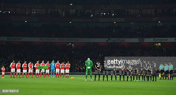 Both teams observe a minutes silence ahead of the EFL Cup quarter final match between Arsenal and Southampton at the Emirates Stadium on November 30...