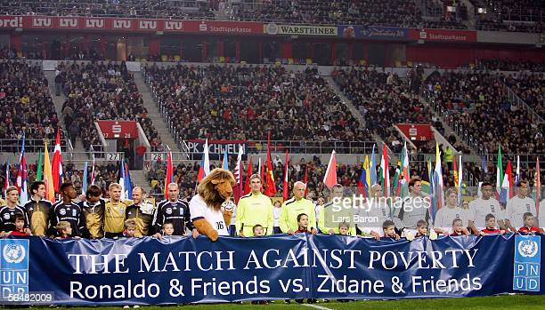 Both teams pose before the benefit game Match Against Poverty between Ronaldo & Friends and Zidane & Friends at the LTU Arena on December 22, 2005 in...
