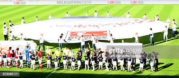 Both teams pose prior to the Bundesliga Play Off match between FC Energie Cottbus and 1.FC Nuernberg at the Stadion der Freundschaft on May 28, 2009...