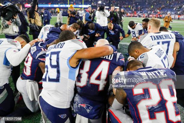 Both teams pray after an AFC Wild Card game between the New England Patriots and the Tennessee Titans on January 4 at Gillette Stadium in Foxborough...