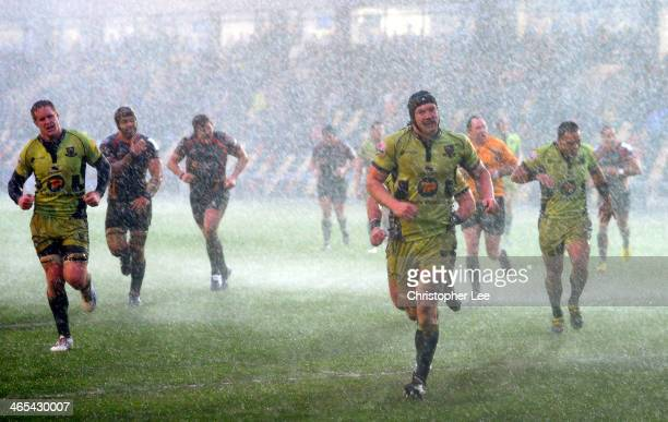 Both teams run into the changing rooms as the match is abandoned for 5 minutes due to a heavy hail storm during the LV Cup match between Newport...