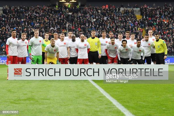 Both teams stand behind a banner against discrimination for the campaign 'Say No to prejudice' an antidiscrimination campaign before the Bundesliga...