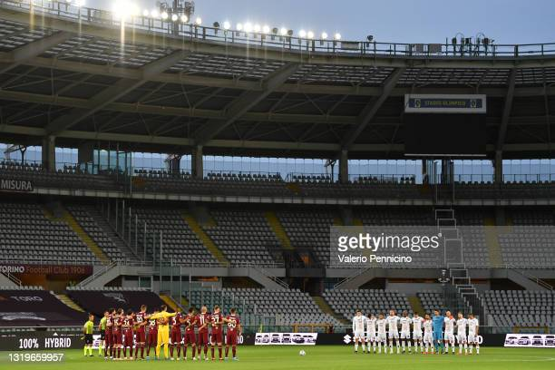 Both teams stand for a minute of silence prior to the Serie A match between Torino FC v Benevento Calcio at Olimpico Stadium on May 23, 2021 in...