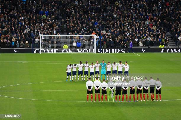 Both teams stand for a minutes silence in honour of Remembrance Day during the Premier League match between Tottenham Hotspur and Sheffield United at...