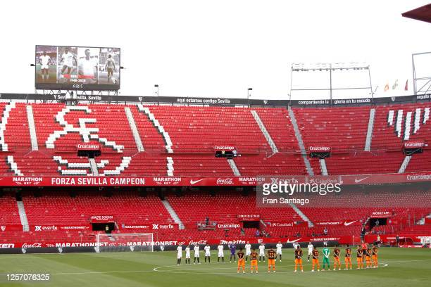 Both teams stand for a minutes silence in memory of Biri Biri during the Liga match between Sevilla FC and Valencia CF at Estadio Ramon Sanchez...