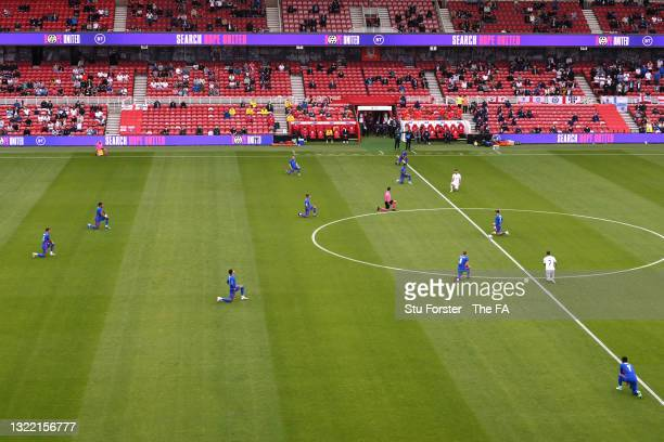 Both team's take a knee in support of the Black Lives Matter movement prior to the international friendly match between England and Romania at...