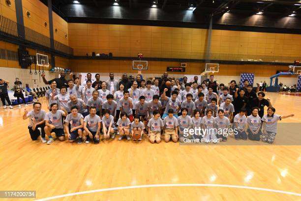 Both the Houston Rockets and Toronto Raptors take a group photo during the NBA Cares Special Olympics Unified Clinic part of the 2019 NBA Japan Games...