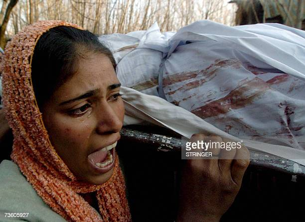 A Kashmiri woman grieves as she carries the body of her relative Gulam Nabi during his funeral ceremony in Botingoo some 56kms north of Srinagar 16...