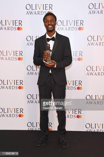 Botis Seva winner of the Best New Dance production for 'Bikdog' poses in the press room at The Olivier Awards 2019 with Mastercard at The Royal...
