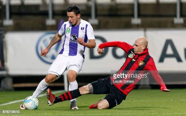 Botond Barath of Budapest Honved slide tackles Branko Pauljevic of Ujpest FC during the Hungarian OTP Bank Liga match between Ujpest FC and Budapest...