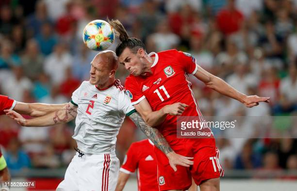 Botond Barath of Hungary and Gareth Bale of Wales compete for a header during the UEFA Euro 2020 Qualifier between Hungary and Wales at Groupama...