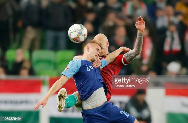 Botond Barath of Hungary battles for the ball in the air with Jasse Tuominen of Finland during the UEFA Nations League group stage match between...
