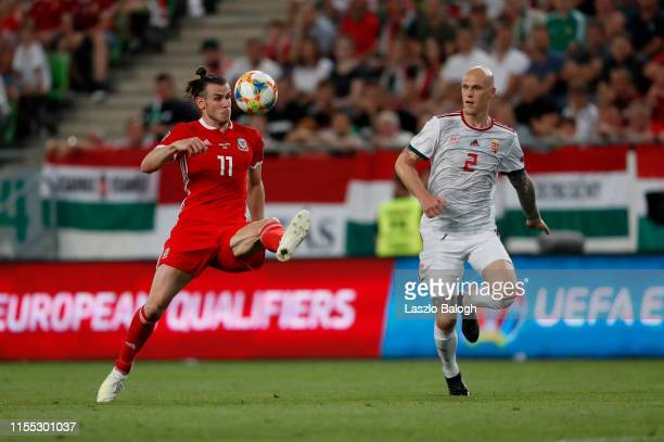 Botond Barath of Hungary competes for the ball with Gareth Bale of Wales compete for a header during the UEFA Euro 2020 Qualifier between Hungary and...