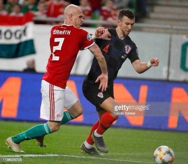 Botond Barath of Hungary competes for the ball with Ivan Perisic of Croatia during the 2020 UEFA European Championships group E qualifying match...