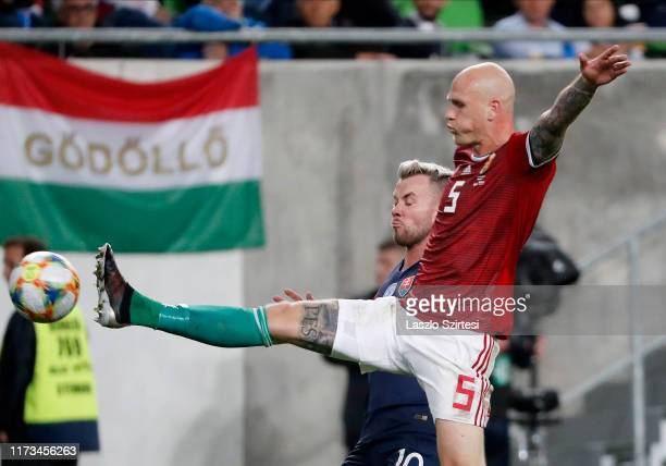 Botond Barath of Hungary fights for the ball with Albert Rusnak of Slovakia during the 2020 UEFA European Championships group E qualifying match...