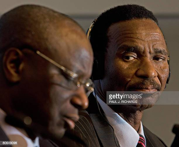 Botswana Minister of Finance Development Planning Baledzi Gaolathe looks on as Senegal's Minister of Economy and Finance Abdoulaye Diop listens to a...