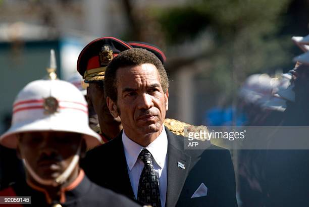 Botswana President Ian Khama reviews an honor guard on October 20 2009 after being swornin as the country�s forth democratically elected president in...