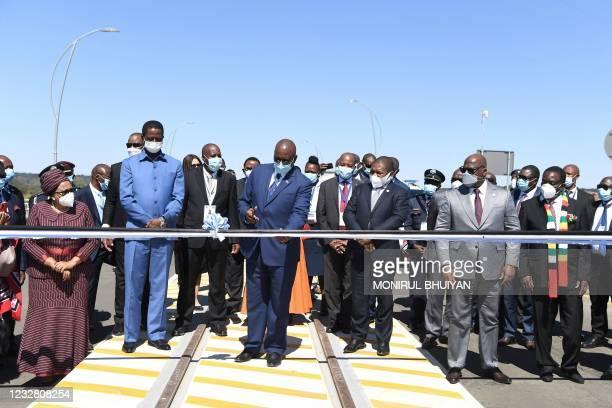 Botswana President Mokgweetsi Masisi cutting a ribbon to mark the official opening of the Botswana side of the Kazungula bridge in Kazungula,...