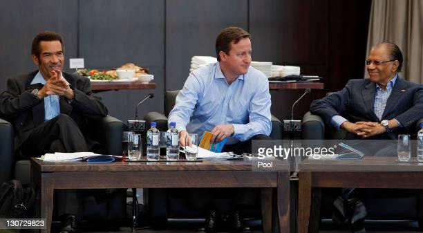 Botswanan President Ian Khama British Prime Minister David Cameron and Mauritius Prime Minister Navichandra Ramgoolam take part in the CHOGM retreat...