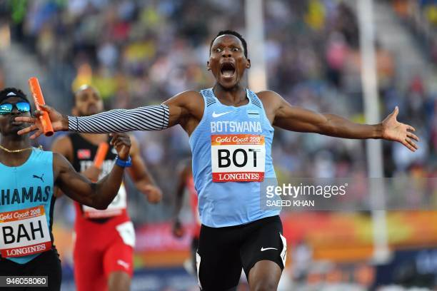 Botswanas Isaac Makwala crosses the finish line to win the athletics men's 4x400m relay final during the 2018 Gold Coast Commonwealth Games at the...