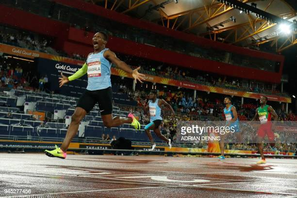 TOPSHOT Botswanas Isaac Makwala reacts as he crosses the finish line to win the athletics men's 400m final during the 2018 Gold Coast Commonwealth...