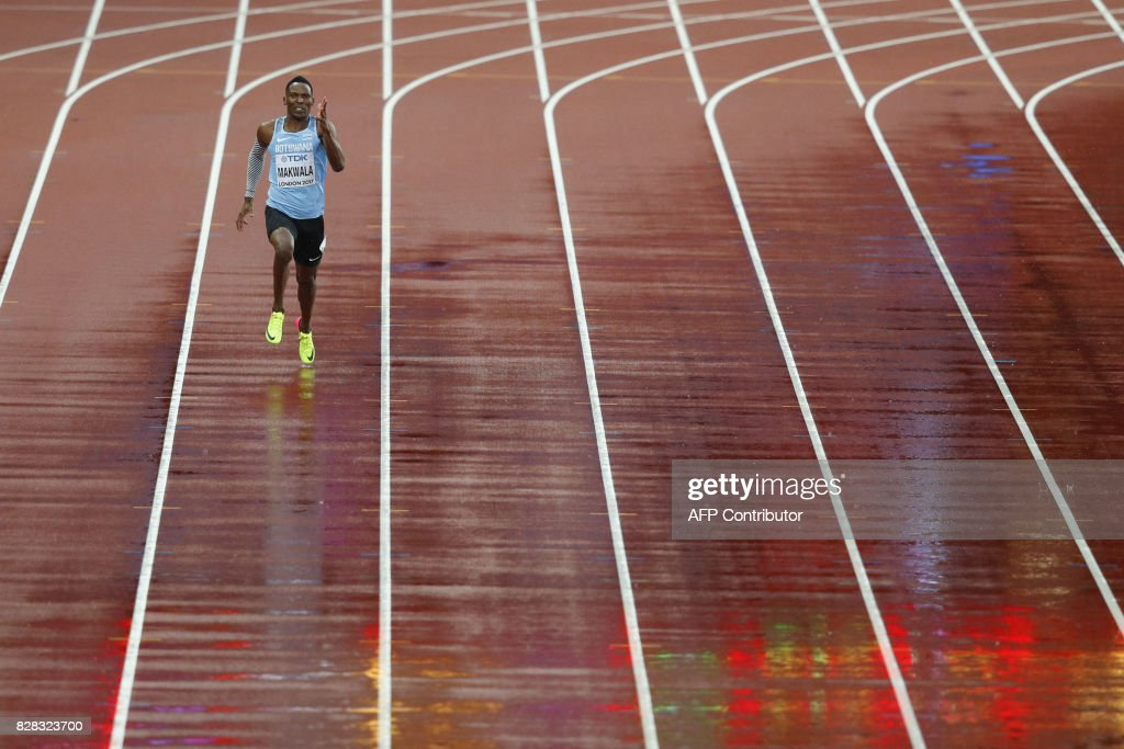 TOPSHOT - Botswana's Isaac Makwala runs alone as he competes in the heats of the men's 200m athletics event at the 2017 IAAF World Championships at the London Stadium in London on August 9, 2017. Makwala was able to compete in the 200 metres at the world championships in London, after the IAAF decided to allow him to run a solo time-trial after missing yesterday's heats. / AFP PHOTO / Adrian DENNIS