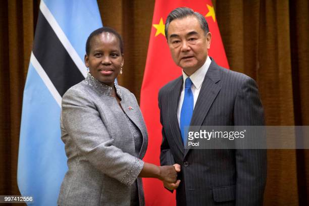 BEIJING CHINA JULY 31 Botswana's Minister of International Affairs and Cooperation Unity Dow left shakes hands with Chinese Foreign Minister Wang Yi...