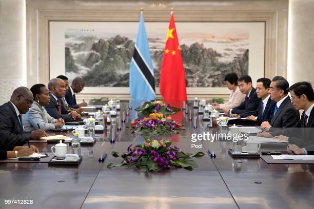 Botswana's Minister of International Affairs and Cooperation Unity Dow second from left listens as Chinese Foreign Minister Wang Yi second from right...