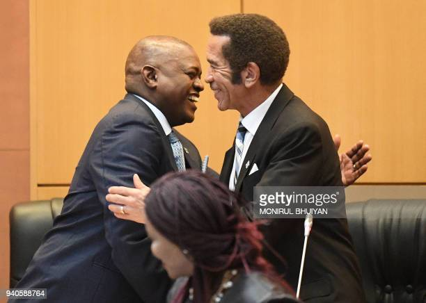 Botswana's new President Mokgweetsi Masisi is congratulated by outgoing president Ian Khama after taking the oath as the 5th President at the...