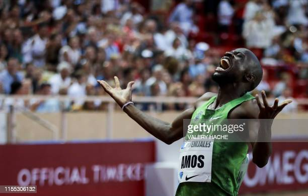 Botswana's Nijel Amos celebrates as he crosses the finish line and wins the Men's 800m during the IAAF Diamond League competition on July 12 2019 in...