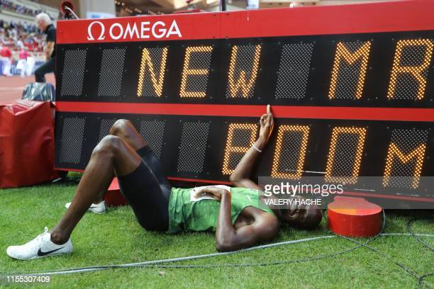 Botswana's Nijel Amos poses with a screen reading his meeting record after winning in the Men's 800m during the IAAF Diamond League competition on...