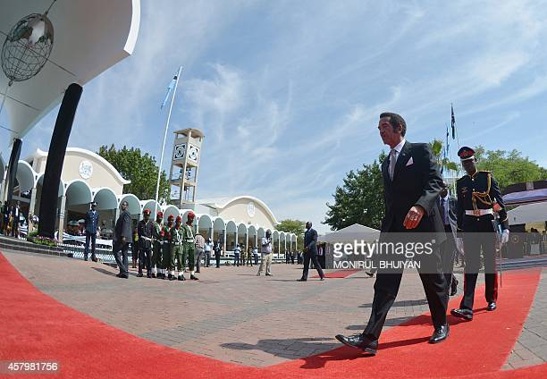 Botswana's President Ian Khama walks to the parliament after he was sworn in for his second term on October 28 2014 in Gaborone after winning...