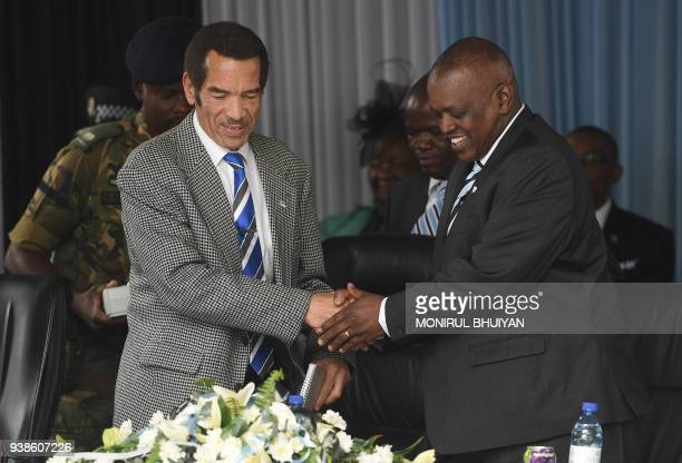 Botswana's President Seretse Ian Khama shakes hands with his vicepresident Mokgweetsi Masisi during a rally in his village Serowe on March 27 before...