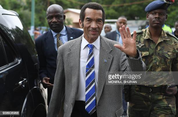 Botswana's President Seretse Ian Khama waves to the crowd as he leaves after a rally in his village Serowe on March 27 before officially stepping...