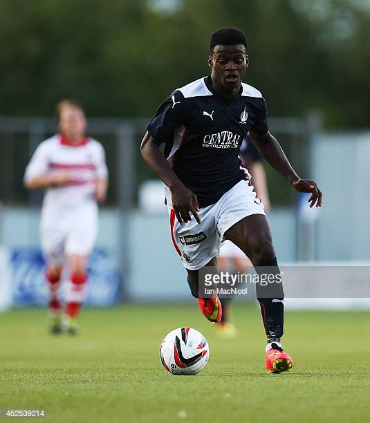Botti Biabi of Falkirk runs with the ball during the Stirlingshire Cup Final match between Falkirk and Stirling Albion at The Falkirk Stadium on July...