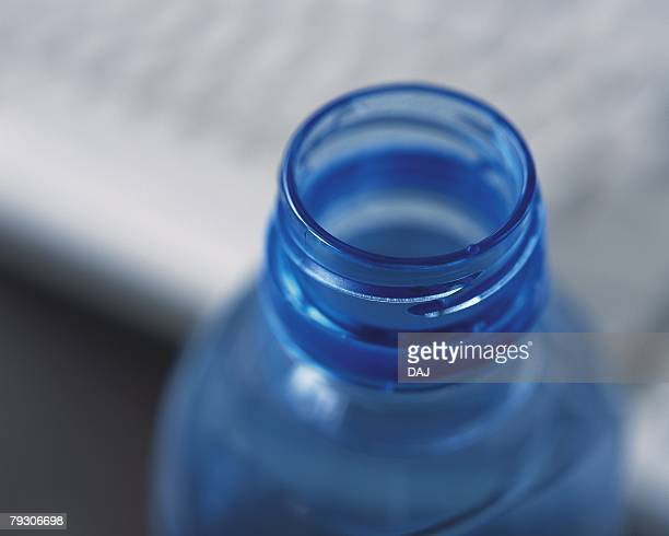 A PET bottle and keyboard, Close Up, High Angle View, Differential Focus