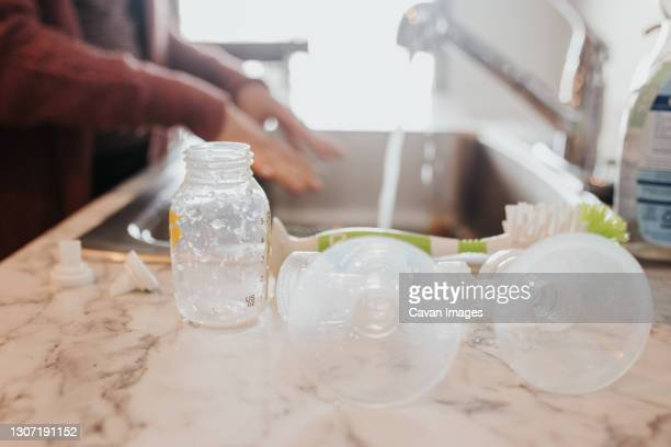 bottle and pumping parts laying out to dry in the kitchen - breast pump stock pictures, royalty-free photos & images