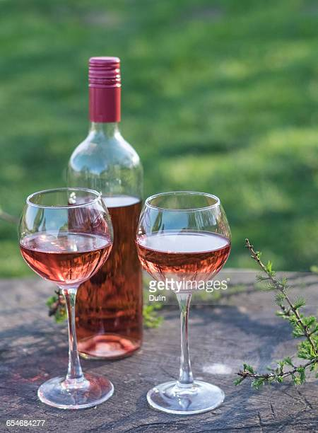 Bottle and two glasses of rose wine