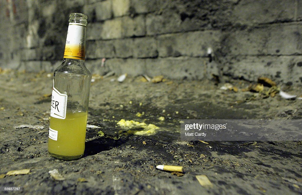 A bottle and vomit left in the street in Bath on October 15, 2005 in Bath, England. Pubs and clubs preparing for the new Licensing laws due to come into force on November 24 2005, which will allow pubs and clubs longer and more flexible opening hours.Opponents of the law believe this will lead to more binge-drinking with increased alcohol related crime, violence and disorder while health experts fear an increase in alcohol related illnesses and alcoholism.