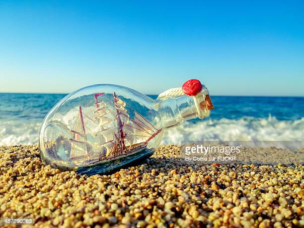 bottle at the beach - ship in a bottle stock pictures, royalty-free photos & images