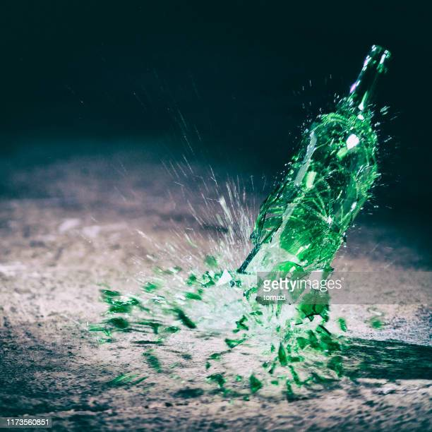 bottle breaking - violence stock pictures, royalty-free photos & images