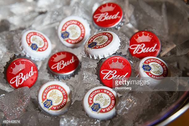 Bottle caps from Peroni beer brewed by SABMiller Plc and Budweiser beer brewed by AnheuserBusch InBev NV sit in a bucket of ice in The Capitol a JD...