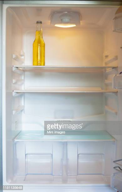 bottle in a refrigerator - empty fridge stock pictures, royalty-free photos & images