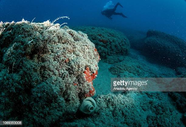 Bottle is stuck under a rock the Samandag Cevlik Akcay diving site off the coasts of Samandag, near the Turkey - Syria border, in Hatay province of...